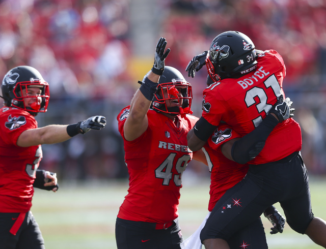 UNLV players celebrate after gaining possession of the ball following a fumble by Wyoming during a football game at Sam Boyd Stadium in Las Vegas on Saturday, Nov. 12, 2016. (Chase Stevens/Las Veg ...