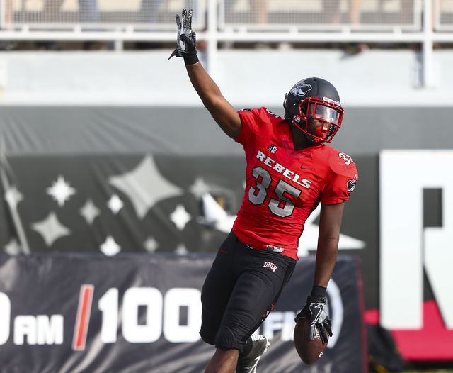 UNLV running back Xzaviar Campbell (35) celebrates his touchdown during a football game against Wyoming at Sam Boyd Stadium in Las Vegas on Saturday, Nov. 12, 2016. (Chase Stevens/Las Vegas Review ...