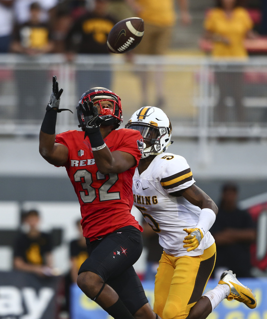 UNLV defensive back Jericho Flowers (32) receives a pass in the end zone to score a touchdown during a football game against Wyoming at Sam Boyd Stadium in Las Vegas on Saturday, Nov. 12, 2016. UN ...
