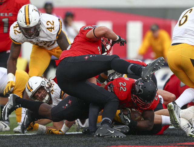UNLV running back David Greene (22) makes it into the end zone to score during a football game against Wyoming at Sam Boyd Stadium in Las Vegas on Saturday, Nov. 12, 2016. UNLV defeated Wyoming 69 ...