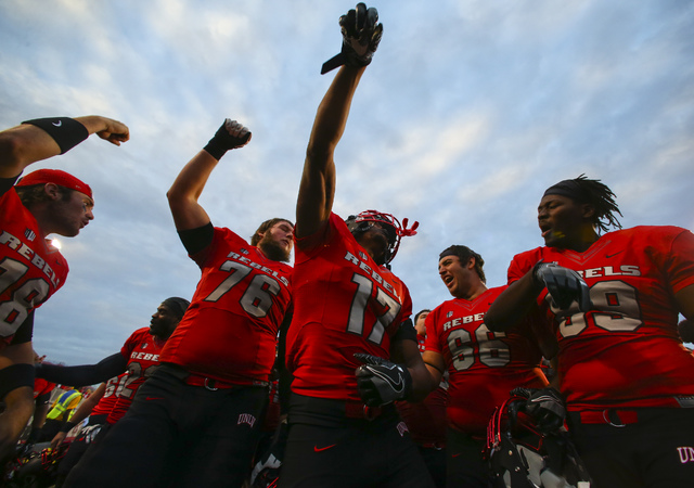 UNLV players celebrate after defeating Wyoming 69-66 in a triple overtime football game at Sam Boyd Stadium in Las Vegas on Saturday, Nov. 12, 2016. Chase Stevens/Las Vegas Review-Journal Follow @ ...