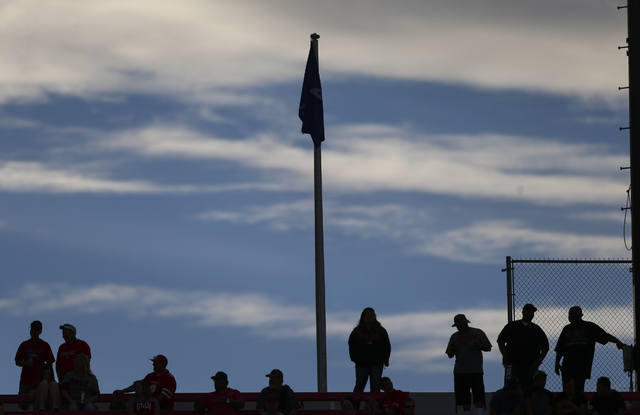 UNLV fans are silhouetted against the sky during a football game against Wyoming at Sam Boyd Stadium in Las Vegas on Saturday, Nov. 12, 2016. UNLV defeated Wyoming 69-66 in triple overtime. Chase  ...