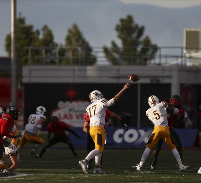 Wyoming quarterback Josh Allen (17) makes a pass during a football game against UNLV at Sam Boyd Stadium in Las Vegas on Saturday, Nov. 12, 2016. UNLV defeated Wyoming 69-66 in triple overtime. Ch ...