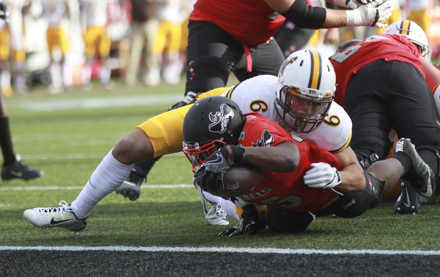 UNLV running back Xzaviar Campbell (35) comes up short at the end zone during a football game against Wyoming at Sam Boyd Stadium in Las Vegas on Saturday, Nov. 12, 2016. UNLV defeated Wyoming 69- ...