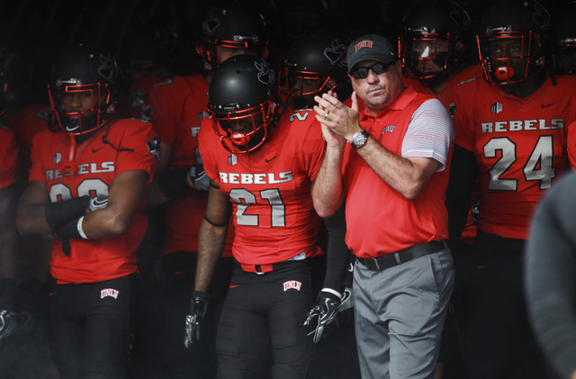 UNLV head coach Tony Sanchez waits to enter the field with his team for a football game against Wyoming at Sam Boyd Stadium in Las Vegas on Saturday, Nov. 12, 2016. UNLV defeated Wyoming 69-66 in  ...