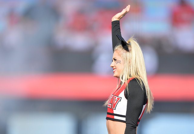 A UNLV Rebels cheerleader waves to the crowd during the UNLV Nevada football game at Sam Boyd Stadium in Las Vegas on Saturday, Nov. 26, 2016. Brett Le Blanc/Las Vegas Review-Journal Follow @blebl ...
