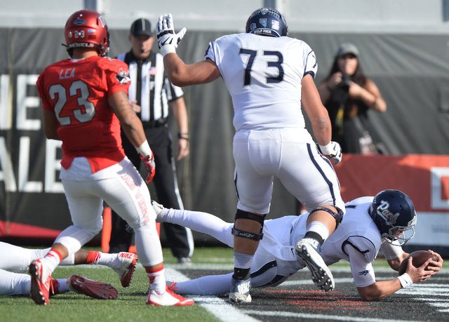 Nevada Wolf Pack quarterback Ty Gangi (6) scores a touchdown during the UNLV Nevada football game at Sam Boyd Stadium in Las Vegas on Saturday, Nov. 26, 2016. Brett Le Blanc/Las Vegas Review-Journ ...
