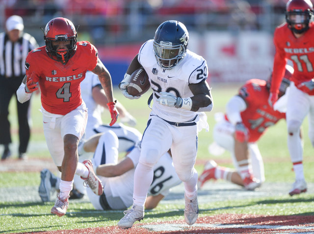 Nevada Wolf Pack running back James Butler (20) runs for a touchdown during the UNLV Nevada football game at Sam Boyd Stadium in Las Vegas on Saturday, Nov. 26, 2016. Brett Le Blanc/Las Vegas Revi ...