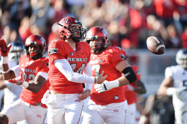 UNLV Rebels quarterback Kurt Palandech (14) tosses the football away after running or a touchdown during the UNLV Nevada football game at Sam Boyd Stadium in Las Vegas on Saturday, Nov. 26, 2016.  ...