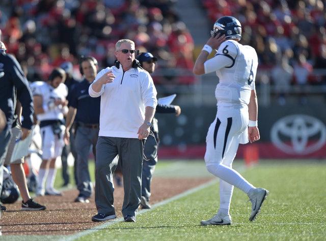 Nevada Wolf Pack head coach Brian Polian talks to Nevada Wolf Pack quarterback Ty Gangi (6) during the UNLV Nevada football game at Sam Boyd Stadium in Las Vegas on Saturday, Nov. 26, 2016. Brett  ...