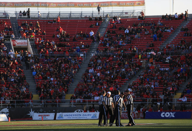Referees meet at midfield during a tv timeout during the UNLV Nevada football game at Sam Boyd Stadium in Las Vegas on Saturday, Nov. 26, 2016. Brett Le Blanc/Las Vegas Review-Journal Follow @bleb ...