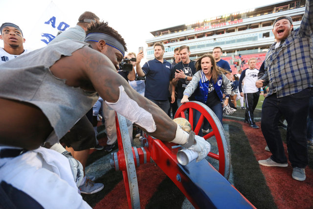 Nevada Wolf Pack running back James Butler (20) paints the Fremont Cannon blue after the Nevada Wolf Pack beat UNLV 45-10 at Sam Boyd Stadium in Las Vegas on Saturday, Nov. 26, 2016. (Brett Le Bla ...