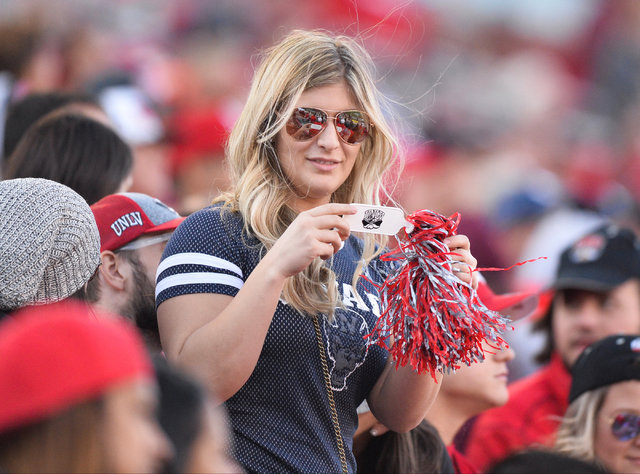 An Nevada Wolf Pack fan holds a UNLV Rebels shaker during the UNLV Nevada football game at Sam Boyd Stadium in Las Vegas on Saturday, Nov. 26, 2016. Brett Le Blanc/Las Vegas Review-Journal Follow  ...