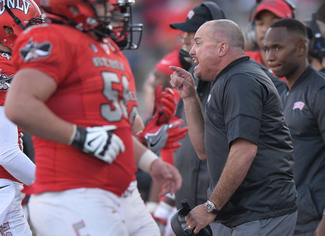 UNLV Rebels head coach Tony Sanchez talks to his team as they return to the sideline during the UNLV Nevada football game at Sam Boyd Stadium in Las Vegas on Saturday, Nov. 26, 2016. Brett Le Blan ...