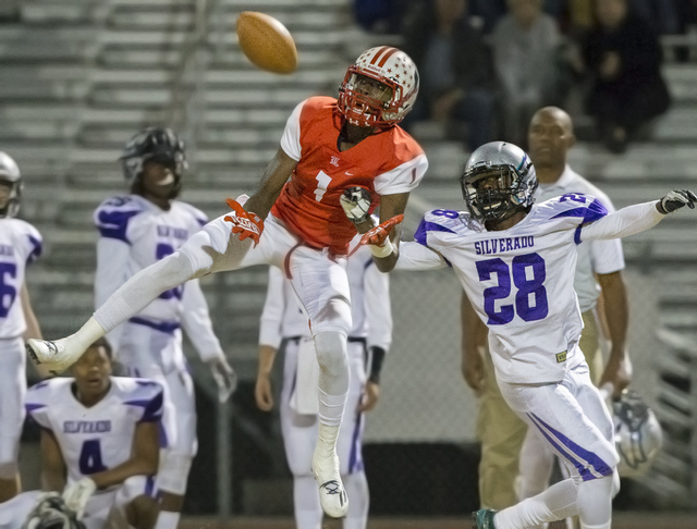 Liberty's Marquez Powell (1) leaps for a pass with Silverado's Thaddeus Wiley (28) defending during the Sunrise Region semifinal game on Thursday, Nov. 10, 2016, at Liberty High School in Henderso ...