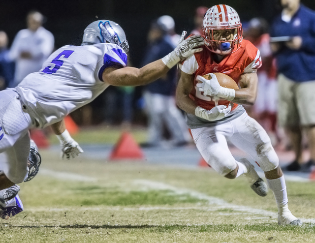 Liberty's Pitts Kishon (25) breaks the tackle of Silverado's Christopher-James Liana (5) during the Sunrise Region semifinal game on Thursday, Nov. 10, 2016, at Liberty High School in Henderson. B ...