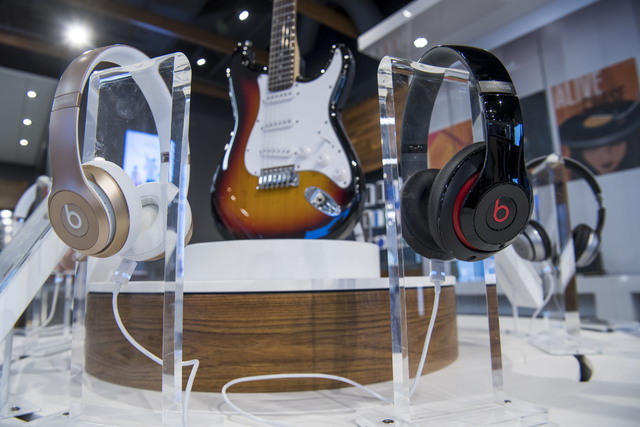 Headphones and a model Fender guitar on Sept. 15, 2016, at the AT&T flagship store in San Francisco, California. (David Paul Morris/Bloomberg)