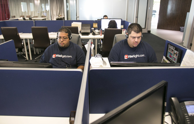 FileRight.com customer service agents Luis Padilla, left, and Jorge Rodriguez work on warm leads at the company's Henderson office on Monday, Nov. 14, 2016. (Richard Brian/Las Vegas Review-Journal ...