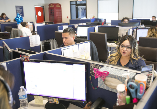 FileRight.com customer service agent Alyssa Herrera, 21, helps a customer while working at the company's Henderson on Monday, Nov. 14, 2016. (Richard Brian/Las Vegas Review-Journal Follow @vegasph ...