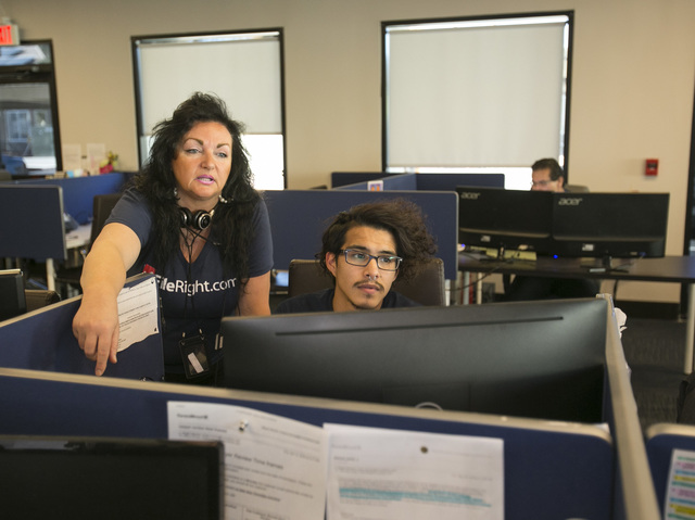 FileRight.com director of quality assurance Renee Wilmot, left, works with customer service agent Geovany Cruz at the company's Henderson office on Monday, Nov. 14, 2016. (Richard Brian/Las Vegas  ...