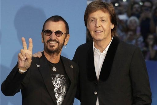 "The Beatles' Paul McCartney, right, and Ringo Starr pose for photographers during the red carpet at the world premiere of Ron Howard's documentary ""Eight Days a Week"" in London, Thursday, Sept. 15 ..."