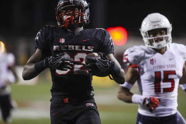 UNLV defensive back Jericho Flowers (32) scores a touchdown during a football game at Sam Boyd Stadium in Las Vegas on Saturday, Oct. 1, 2016. (Miranda Alam/Las Vegas Review-Journal) Follow @miran ...