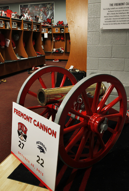 The Fremont Cannon trophy sits in the UNLV football locker room with a fresh coat of red paint on Nov. 12, 2013. (Jason Bean /Las Vegas Review-Journal)