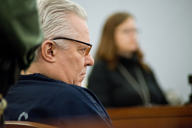 David Frostick, who was convicted in the 2009 murder of his girlfriend, Robin Lesley Jenkins, watches a video showing an altercation he had with a corrections officer during court proceedings at t ...