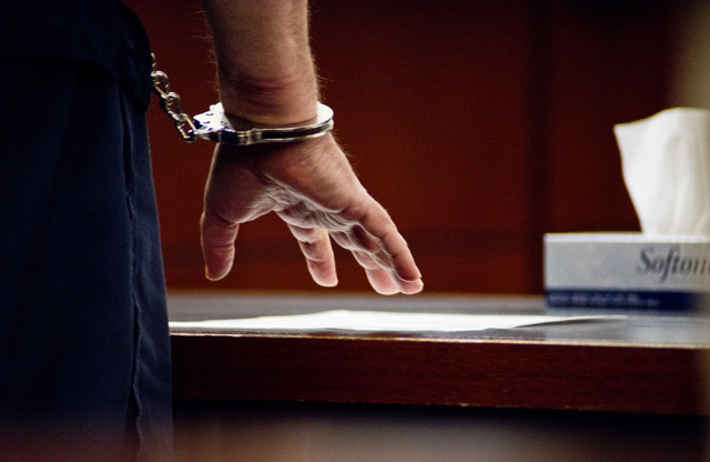 David Frostick, who was convicted in the 2009 murder of his girlfriend, Robin Lesley Jenkins, reviews court documents during court proceedings at the Regional Justice Center in downtown Las Vegas  ...