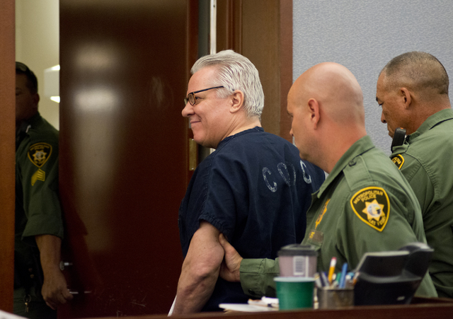 David Frostick, who was convicted in the 2009 murder of his girlfriend, Robin Lesley Jenkins, is led out of the courtroom after court proceedings at the Regional Justice Center in downtown Las Veg ...