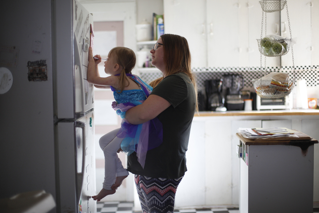 Acacia Hathaway holds her daughter Ella as she writes a grocery list on Friday, Nov. 4, 2016, at their home in Tonopah, Nev. Rachel Aston/Las Vegas Review-Journal Follow @rookie__rae