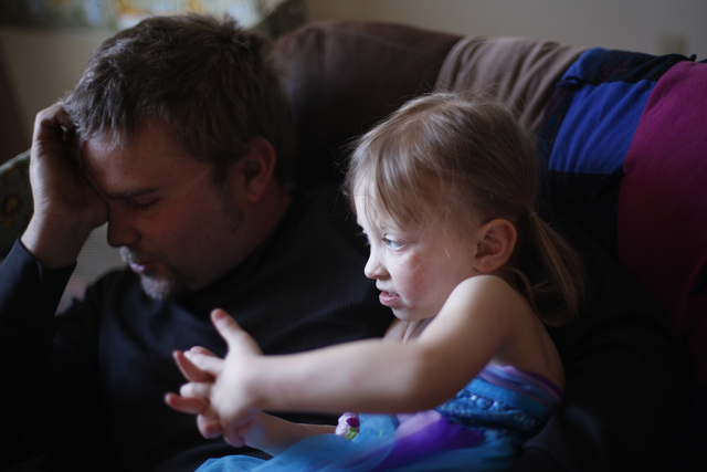 Justin Hathaway rests at home with his daughter Ella on Friday, Nov. 4, 2016, in Tonopah, Nevada. Rachel Aston/Las Vegas Review-Journal Follow @rookie__rae