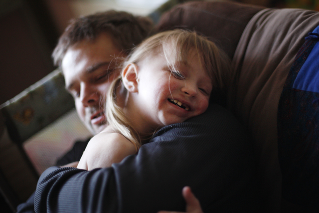 Justin Hathaway hugs his daughter Ella at their home on Friday, Nov. 4, 2016, in Tonopah, Nevada. Rachel Aston/Las Vegas Review-Journal Follow @rookie__rae