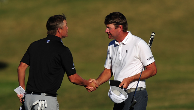 PGA golfer Lucas Glover, right, shakes hands with Matt Jones on the 18h hole during the Shriners Hospitals for Children Open at TPC Summerlin in Las Vegas Saturday, Nov. 5, 2016. Josh Holmberg/Las ...