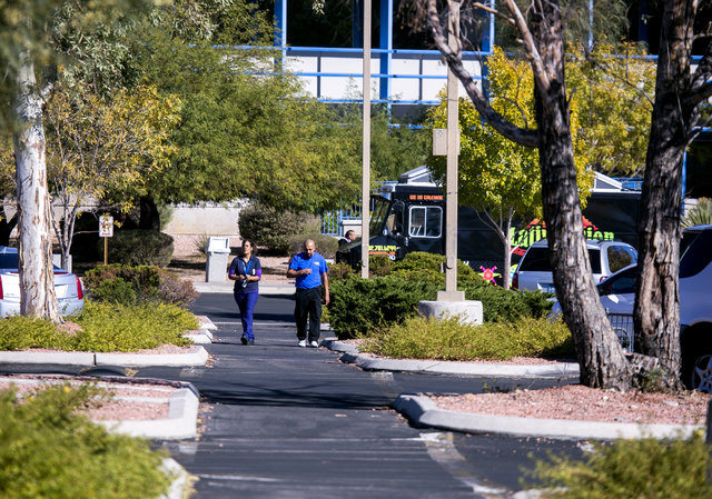 People walk in the parking lot at Sutherland Global Services, 8725 W. Sahara Ave., on Thursday, Nov. 17, 2016. The Governor's Office of Economic Development approved tax abatements for a handful ...