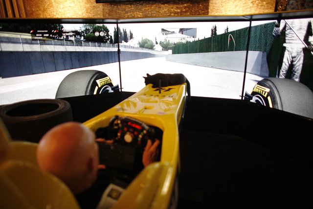 Author Terry Goodkind uses a racer simulator as his cat rides the front at his home on Sunday, Nov. 20, 2016, in Southern Nevada. (Rachel Aston/Las Vegas Review-Journal Follow @rookie__rae)