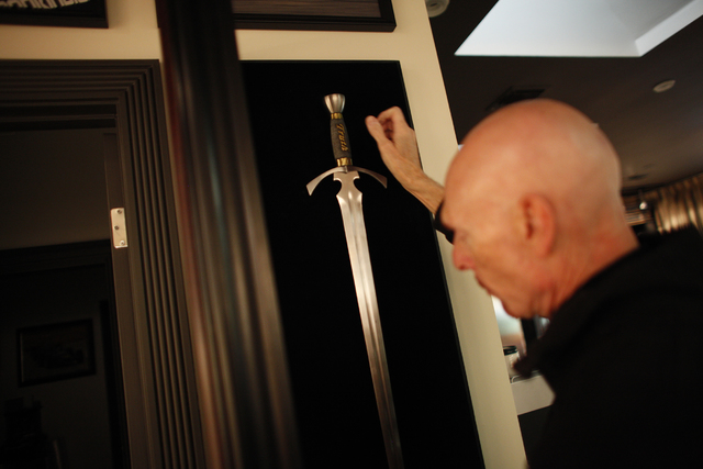"Author Terry Goodkind pulls out ""The Sword of Truth,"" made to represent his book series of the same name at his home on Sunday, Nov. 20, 2016, in Southern Nevada. (Rachel Aston/Las Vegas Review-Jo ..."