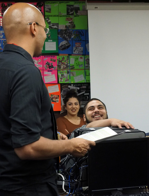 Students Julissa Canal, 17, and Pedro Lopez, 18, listen as teacher Brandon Singleton discusses class events during a Jobs of America's Graduates (JAG) class at Las Vegas High School Oct. 19, 2016. ...