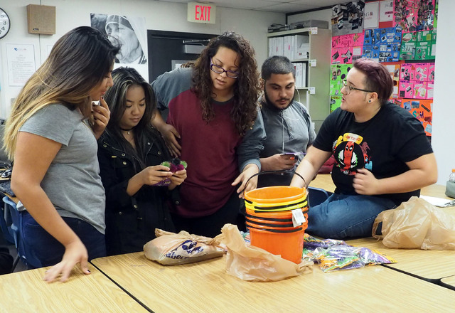 """Students Guadalupe Sanchez, 17, Mary Grace Batangan, 17, Maribel Quezada, 18, Pedro Lopez, 18, and Emery Cox, 17, left to right, discuss the upcoming class event """"Trunk N Treat"""" during a Jobs of A ..."""