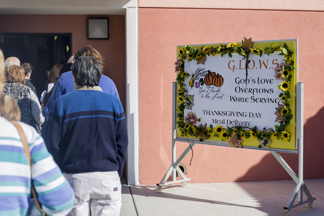 Volunteers stand in line at St. Thomas More Catholic Community in Henderson to deliver meals to seniors on Thanksgiving, Thursday, Nov. 24, 2016, Las Vegas. Elizabeth Page Brumley/Las Vegas Review ...