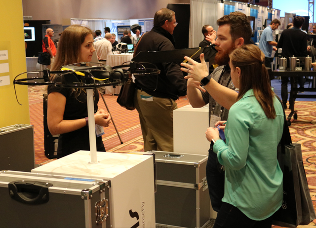 Julie Foguenne (left) with Sensefly speaks with Emily Porche and Cody Porche of Porche Aerial Imagery about the Albris drone, made for inspections, during the Commercial UAV Expo at the MGM Grand  ...