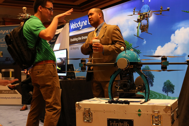 "Andrew Stewart (left) speaks with Vitad Pradith with Hypack, about the Nexus 800 drone during the Commercial UAV Expo at the MGM Grand in Las Vegas Tuesday, Nov. 1, 2016.  ""It operates as ..."