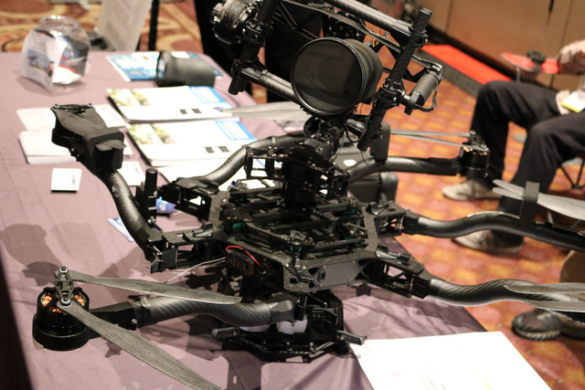AviSight and System Integration Plus display a drone carrying their Ranger 30x optical zoom camera at the Commercial UAV Expo at MGM Grand in Las Vegas, Tuesday Nov. 1, 2016. The camera weighs und ...
