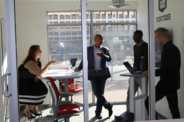 From left to right: Julie Ware, Terik Brown, Beifa Somda, and Johan Axelqvist, the team behind tech startup Snagg.io, prepare to pitch to investors at RedFlint Tuesday, Nov. 22, 2016. (Nicole Raz/ ...