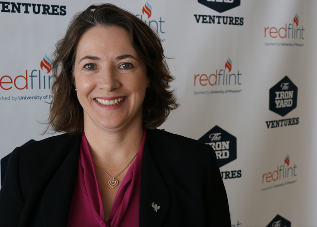 Ruth Veloria, executive dean of the University of Phoenixճ school of business, waits for RedFlint's inaugural startup accelerator class to pitch investors during RedFlint's first Investor Da ...