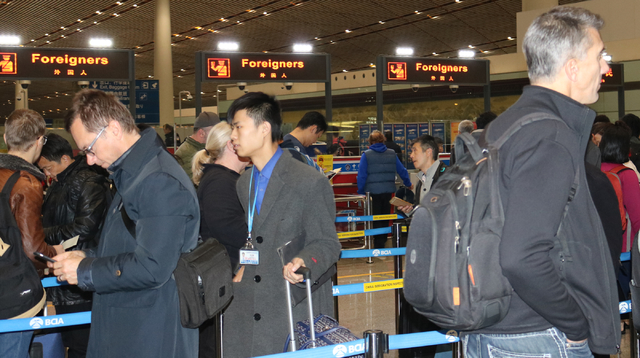 Foreign visitors to Beijing use English-language signage to navigate around the Beijing Capital International Airport Tuesday, Nov. 29, 2016. (Nicole Raz/Las Vegas Review-Journal)