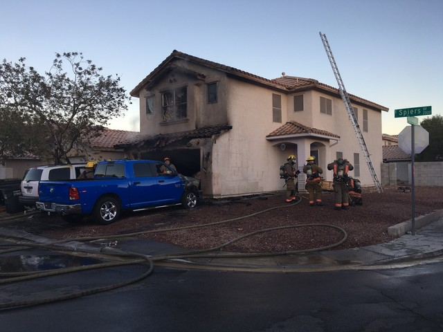 Firefighters respond to a house fire at 2004 Spiers Avenue. (Clark County Fire Department)