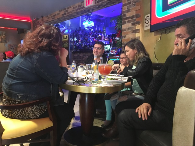 Sergio Perez, center, sits with a table of customers discussing the death of former Cuban President Fidel Castro at his restaurant Florida Cafe Cuban Bar & Grill inside The Shalimar Hotel on S ...
