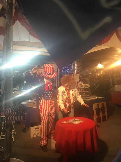 """Uncle Sam (alias artist Stewart Freshwater) and artist Diane Bush show October First Friday attendees how to """"Let America Break Again"""" as part of the satirical """"Dishing It Out"""" art project Bush or ..."""
