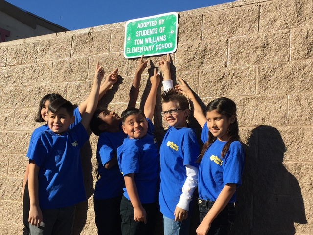 Tom Williams Elementary School students point to a sign noting their adoption of the corner of Pecos Road and Owens Avenue on Tuesday, Nov. 29, 2016. (City of North Las Vegas)